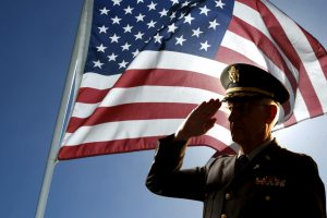 American veteran saluting flag